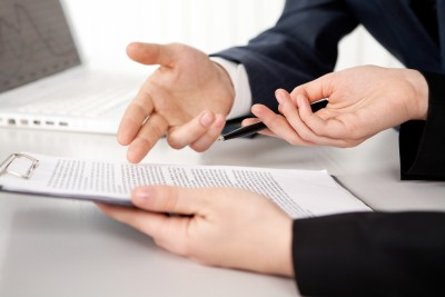 Hands of two businesspeople discussing a contract